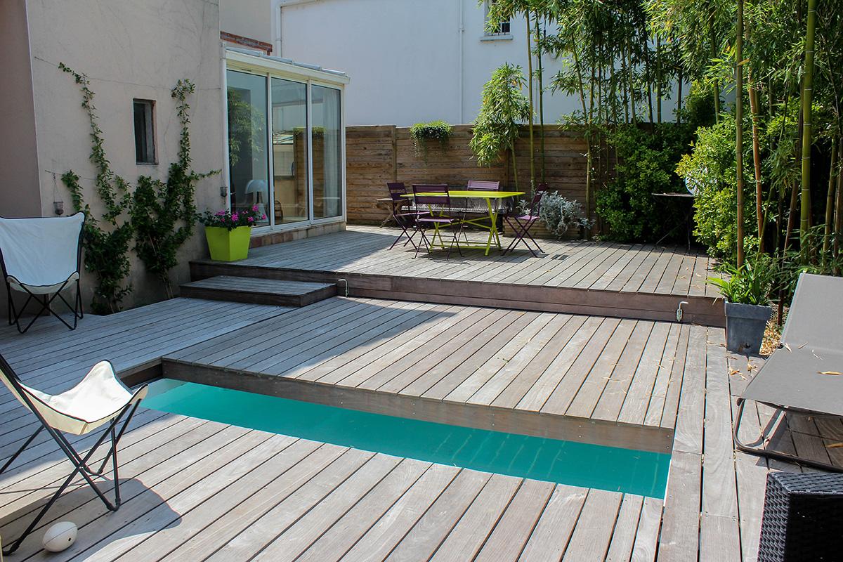 Terrasse bois coulissante sur piscine